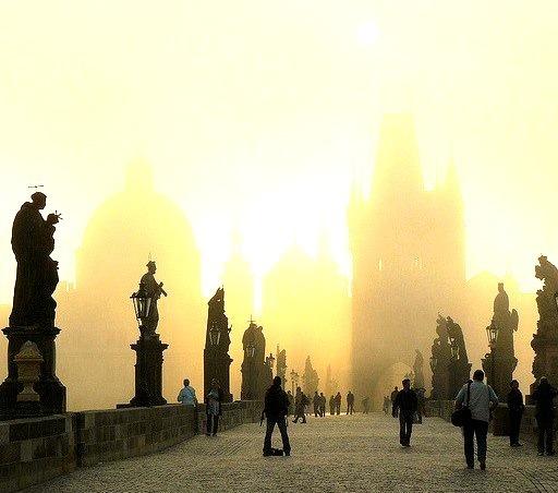 by n_ila on Flickr.Early sunrise at Charles Bridge, Prague, Czech Republic.