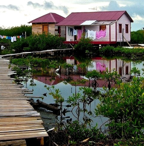 by David C on Flickr.Swamp House in Belize lagoon.