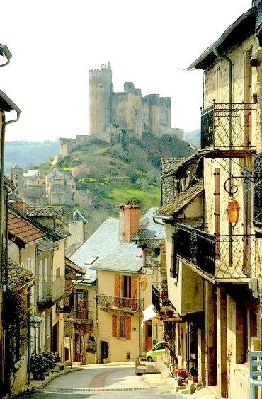 A beautiful mountain village, with a ruined castle at the end of the street, Najac, France