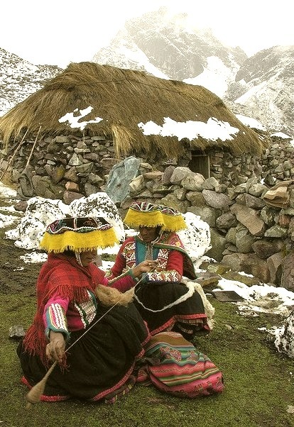 Quechua natives at the footsteps of Ausangate Peak in Cordillera Vilcanota, Peru
