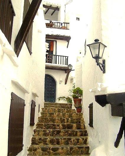 Alley steps in Binibeca Vell, Menorca Island, Spain